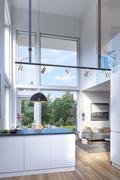 Suuret ikkunat luovat valoisuutta taloon.
